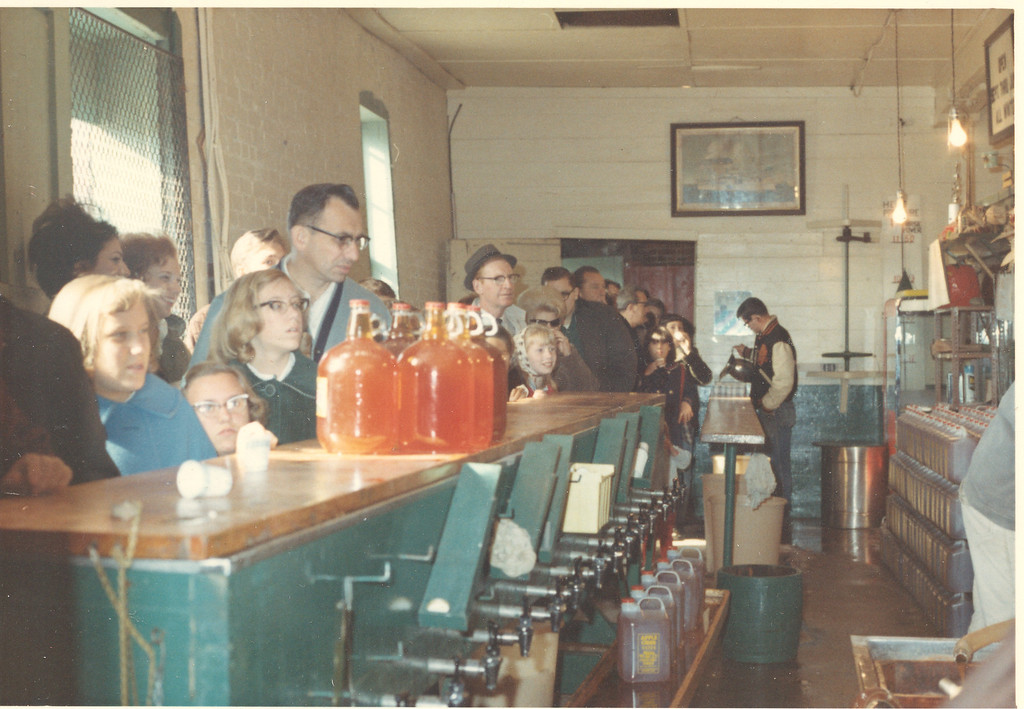 Description of . Customers line up to buy cider and other goodies at Yates Cider Mill in 1966. (Photos courtesy of Yates Cider Mill)